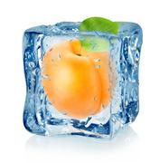 Stock Photo of ice cube and apricot isolated