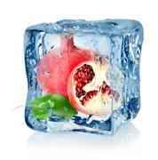 Ice cube and pomegranate Stock Photos