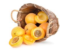ripe apricots in a wooden basket - stock photo