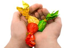 Candies in a hand Stock Photos