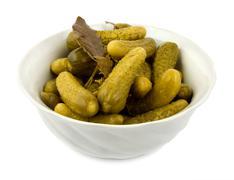 Salt cucumbers in a dish Stock Photos
