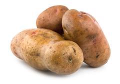 three potatoes isolated - stock photo