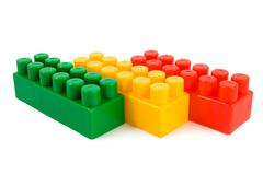 Stack of colourful building blocks isolated Stock Photos