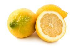 Three ripe lemons Stock Photos