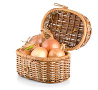 onion in a wooden basket - stock photo