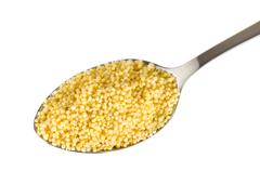 millet in a spoon - stock photo
