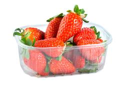 Strawberries in plastic container Stock Photos