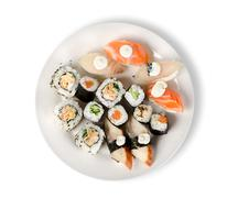 sushi and rolls in a plate isolated - stock photo