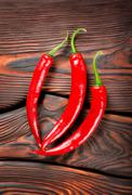 Three red chili peppers Stock Photos