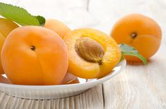 apricot on the table - stock photo