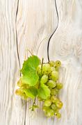 Green grapes on the table Stock Photos