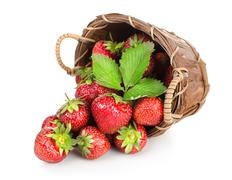 Strawberries in a wooden basket Stock Photos
