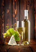White wine with grapes and blue cheese Stock Photos
