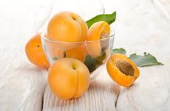 apricots on a wooden background - stock photo