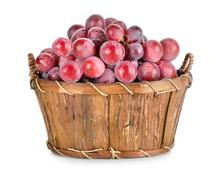 dark blue grapes in a wooden basket isolated - stock photo