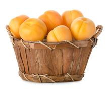 raw apricots in a basket - stock photo
