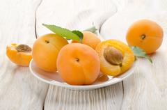 apricots in a white plate - stock photo