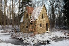 Stock Photo of ruin forest lodge home in winter