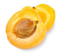 ripe apricot sectioned by knife - stock photo