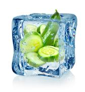 Ice cube and cucumber Stock Photos
