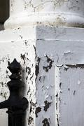 peeling paint coloumn disrepair architectual cracks - stock photo