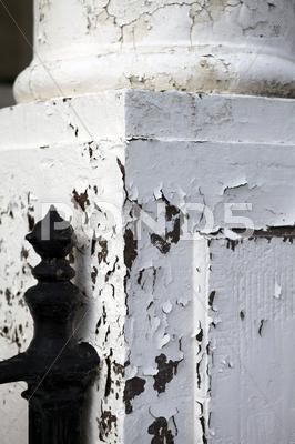 Stock photo of peeling paint coloumn disrepair architectual cracks
