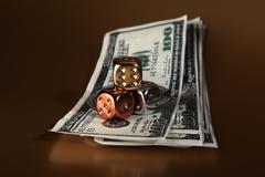 Stock Photo of dice dollars money risk