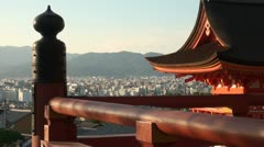 Shadows of trees on beautiful red temple in Kyoto, Japan Stock Footage
