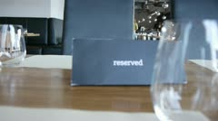 """""""Reserved"""" sign in restaurant table Stock Footage"""