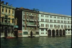 POV from gondola on The Grand Canal, Venice, Italy, long shot, making turn Stock Footage