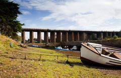 river boats low tide bridge england - stock photo
