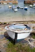 cornwall boats harbor mousehole fishing villlage - stock photo