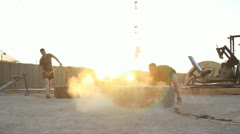 Soldier flipping huge tire for pt in Afghanistan (HD)c Stock Footage