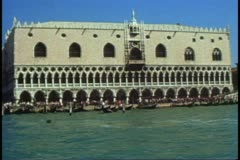 POV from gondola on The Grand Canal, Venice, Italy, pass The Doge's Palace Stock Footage
