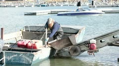 Commercial carp fisherman unloading fish HD 0793 Stock Footage
