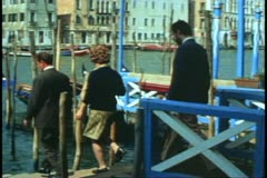 Italian Family, Venice, Italy, Father boards the traghetto, gondola Stock Footage