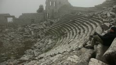 Man dreaming in ancient amphitheater Stock Footage