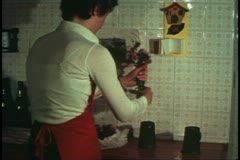 Woman, Venice, Italy, in her kitchen, unpacking flowers, medium shot Stock Footage