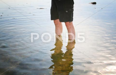 Stock photo of legs water sea paddle