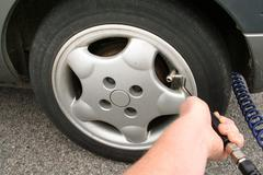 inflate tyre car wheel - stock photo