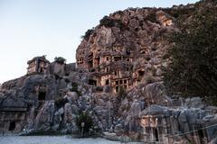 ancient myra rock tomb at turkey demre - stock photo