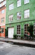 Colorful town houses in street in copenhagen Stock Photos