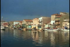 Chiogga, Italy, fishing village, pan right, sea in foreground, no people Stock Footage
