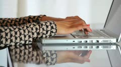 Girl typing on a laptop Stock Footage