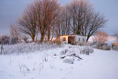 Stock Photo of farm building in snow