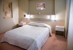 Bedroom in sunlight Stock Photos