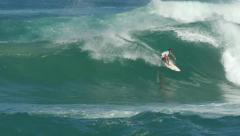 Surfer surfing in big wave north shore Hawaii 60fps Stock Footage