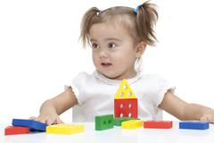 Girl playing with colored blocks - stock photo