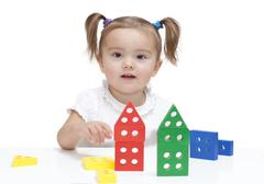 Little girl playing with blocks Stock Photos