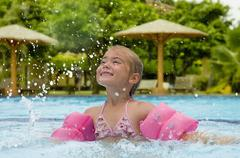 Little girl having fun splashing water - stock photo